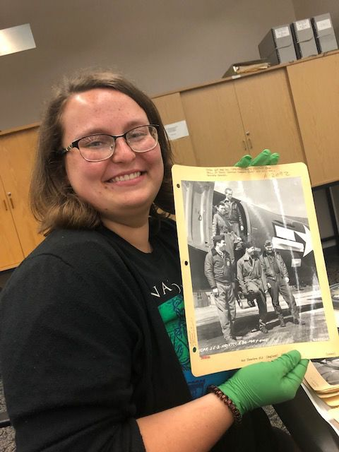 Emily Rinick holding a picture of Mitchell Woods Bacon