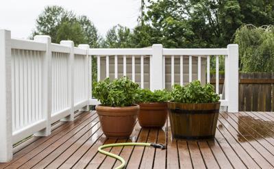 Watering Garden Plants on Patio