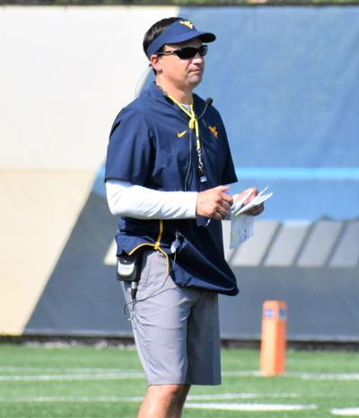 Neal Brown with redd column
