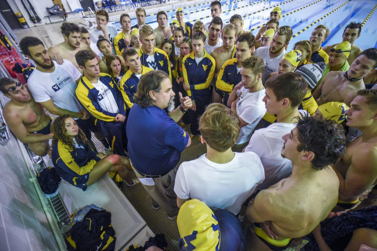Snapshot of the swimming and diving team huddled