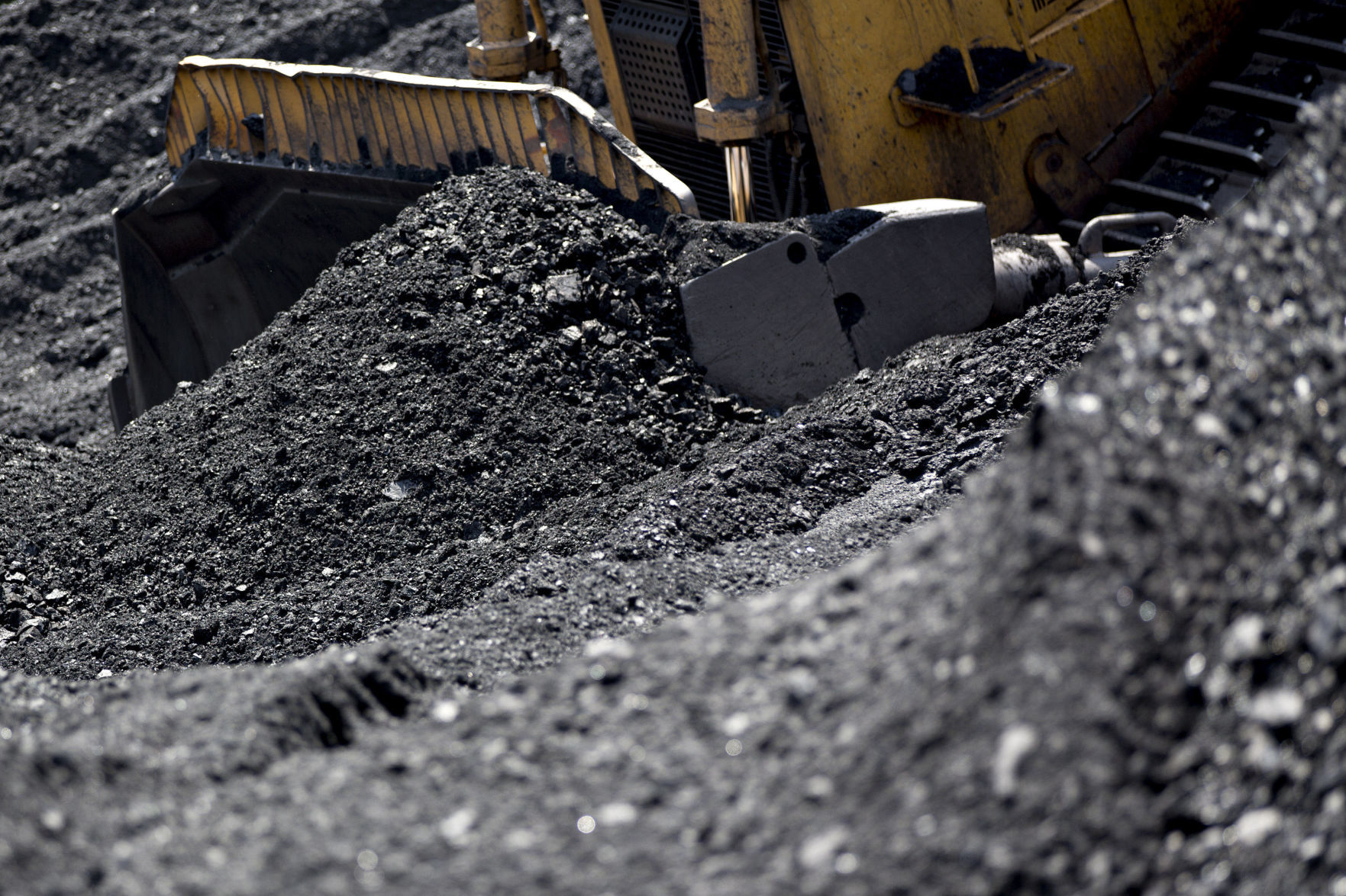 A dozer pushes raw coal at a