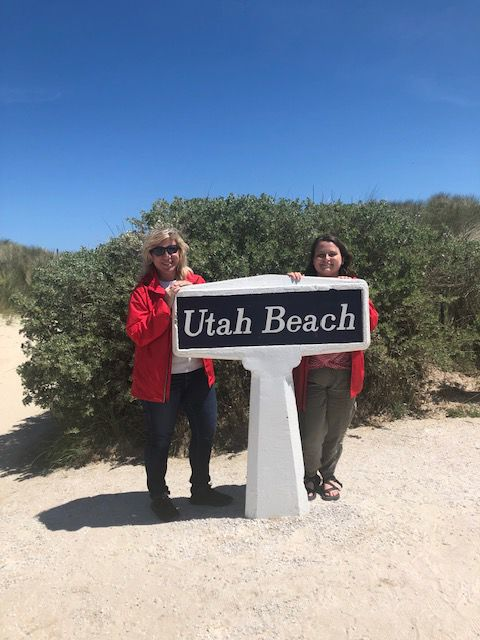 Kizmet and Emily stand on Utah Beach