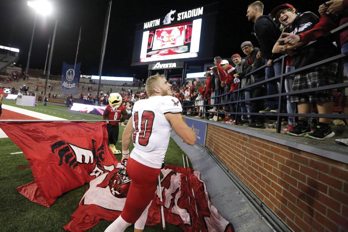 EWU receiver Cooper Kupp celebrates with Eagles fans after his team knocked off Washington State. (Young Kwak/AP via Yakima Herald)