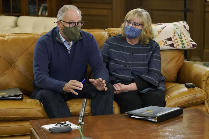 Washington Gov. Jay Inslee and his wife, Trudi, wear masks before taking them off for a final rehearsal in the governor's office before making a statewide televised address on COVID-19, which health officials have warned is accelerating rapidly throughout the state, Thursday, Nov. 12, 2020, at the Capitol in Olympia, Wash.