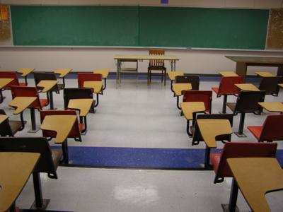 Empty classroom school students desks