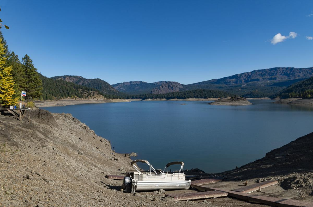 Docks and boats sit on the now dry lakebed at Rimrock Lake Resort