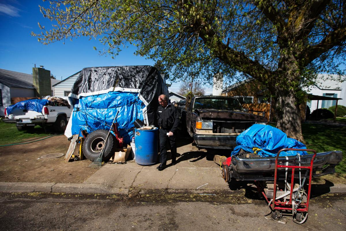 Cleaning up the city, one overgrown yard, junked car, or abandoned ...