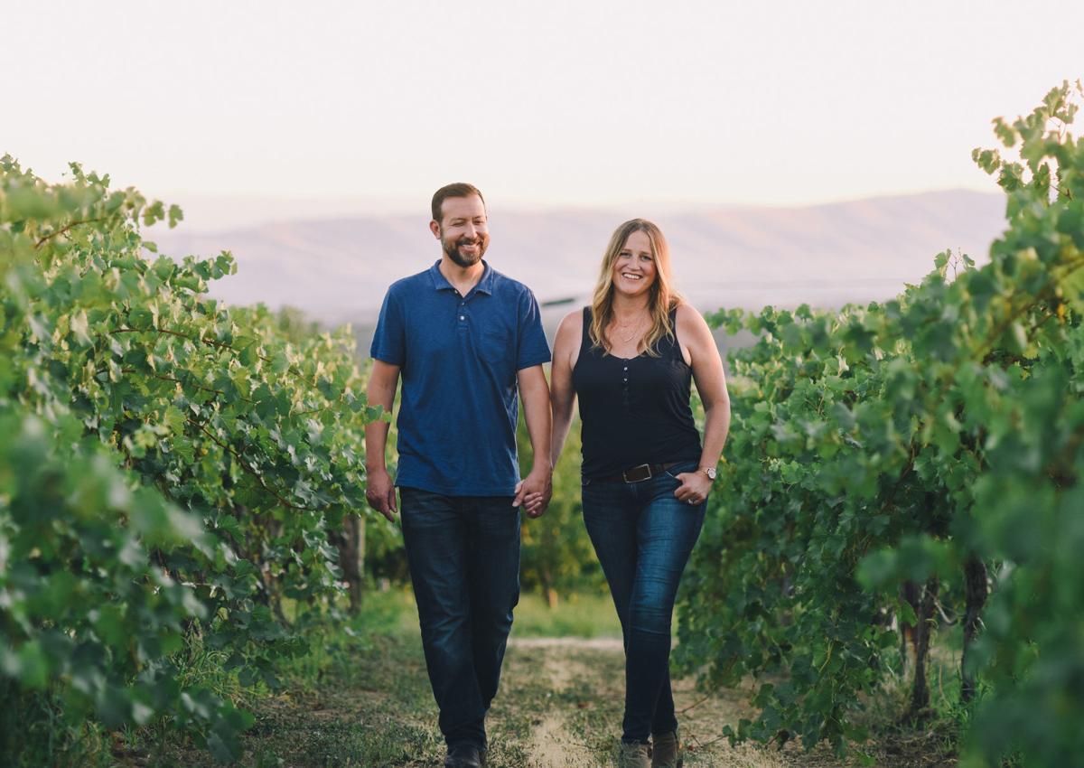 Em and Lee Walking vineyard.jpg