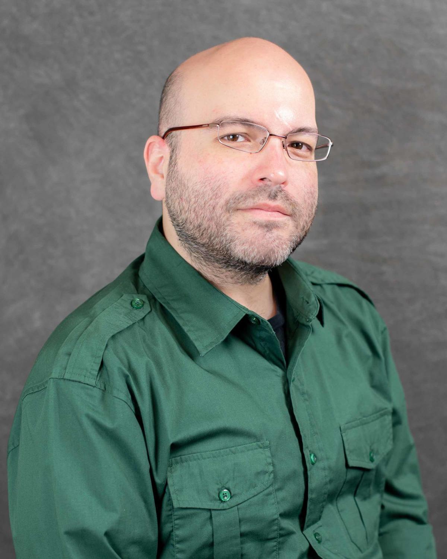 Dr. Travis Dennison