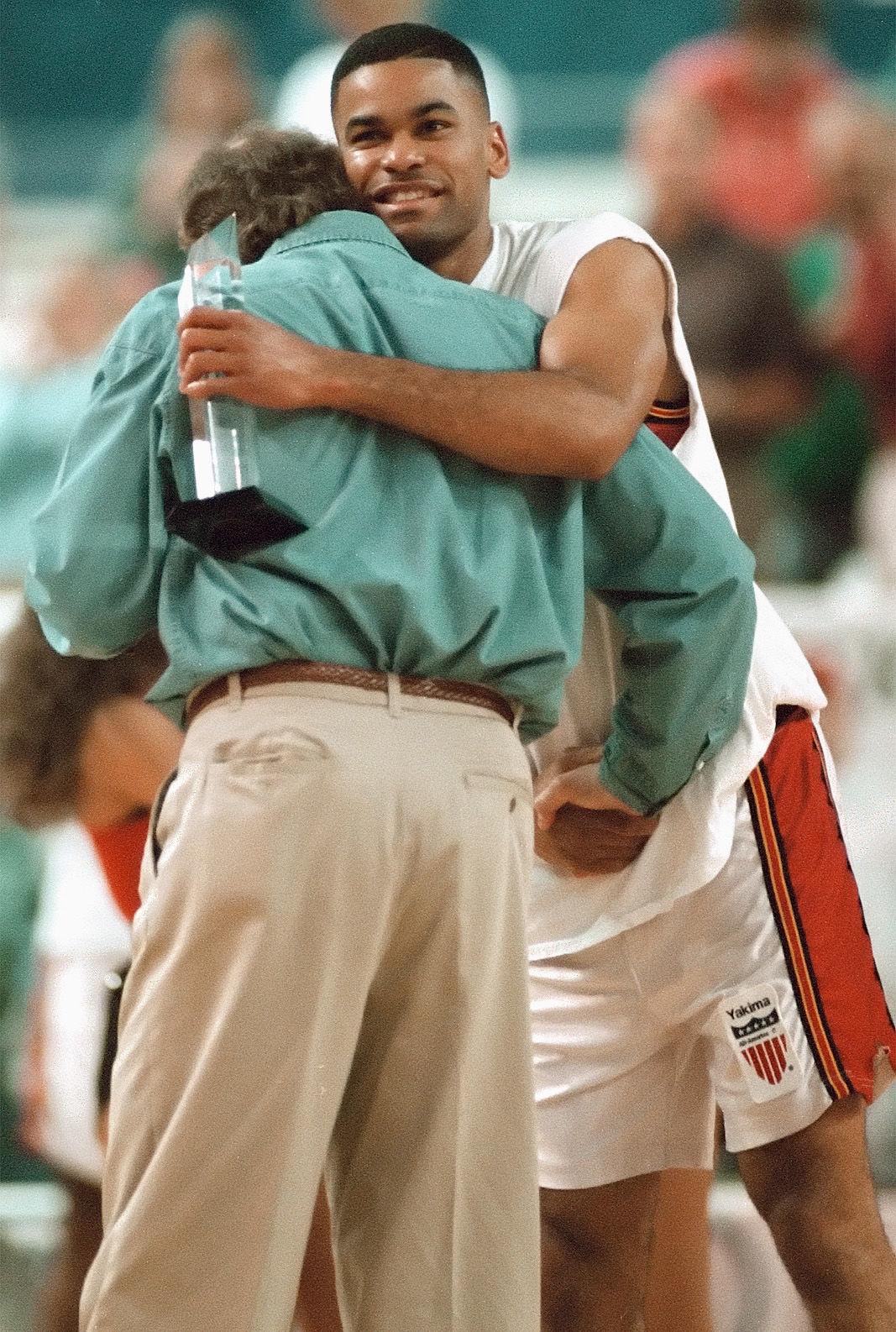 200517-yh-sports-yh-sports-recasner-hug.jpg