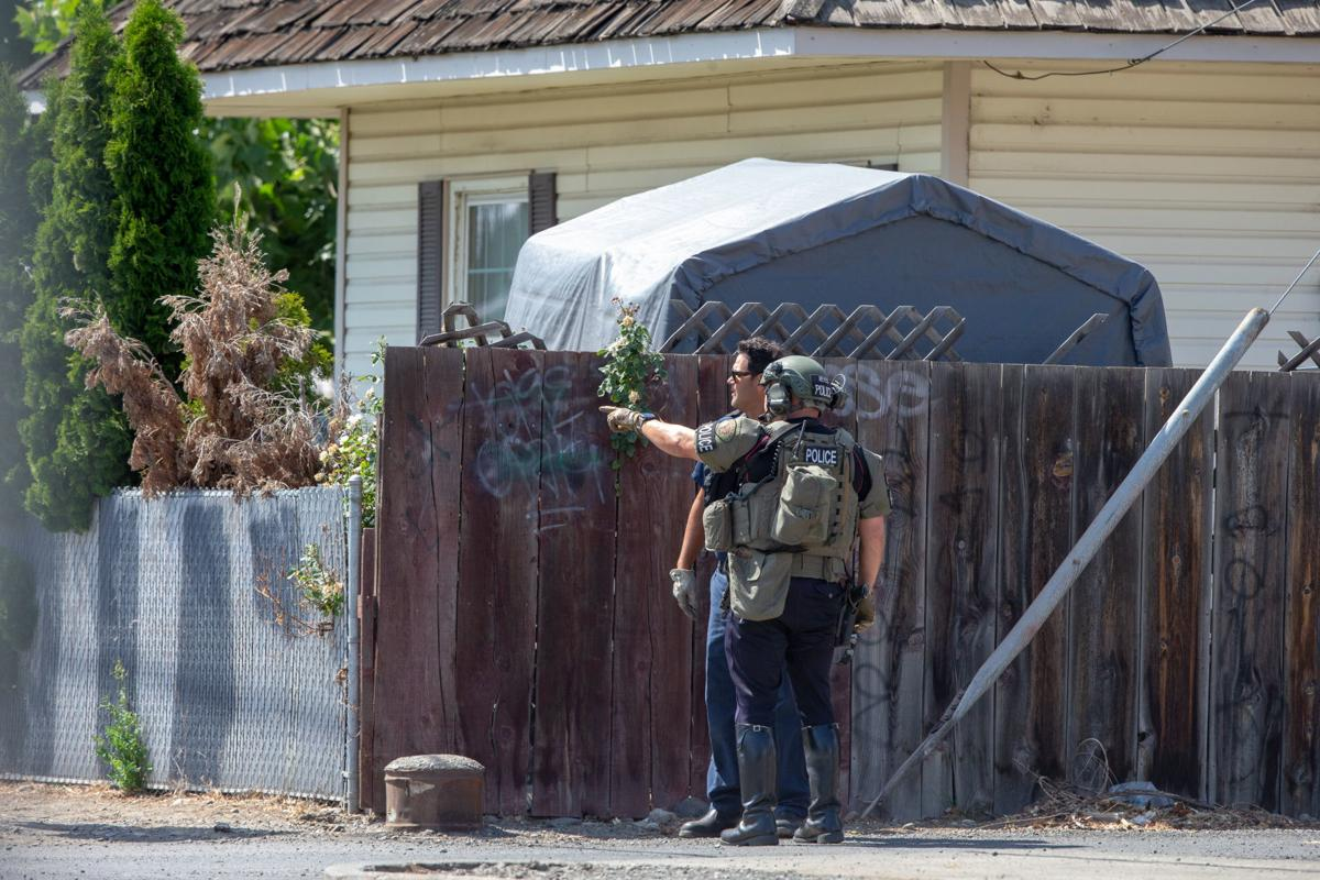 Police responding to a standoff with a man on the roof of the Pacific Apartments on S. 6th Avenue in Yakima, Wash.  The standoff lasted for several hours on the afternoon of Wednesday, July 3, 2019 before the man was taken into police custody.
