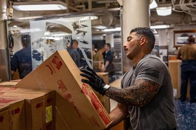 Greensboro Native handles supplies during underway replenishment aboard U.S. Navy warship