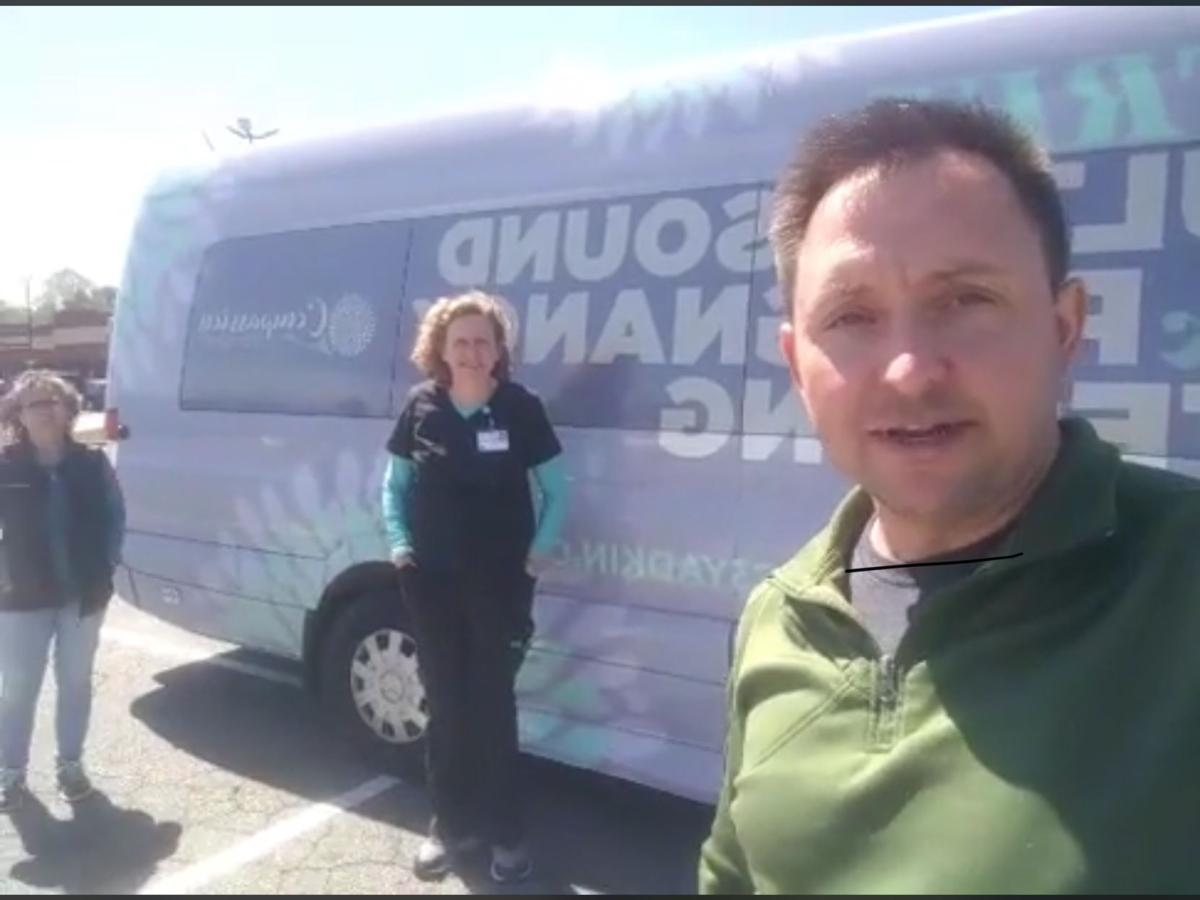 Pastor Jason Doolittle live streams in front  of New Hope Pregnancy Care van.PNG