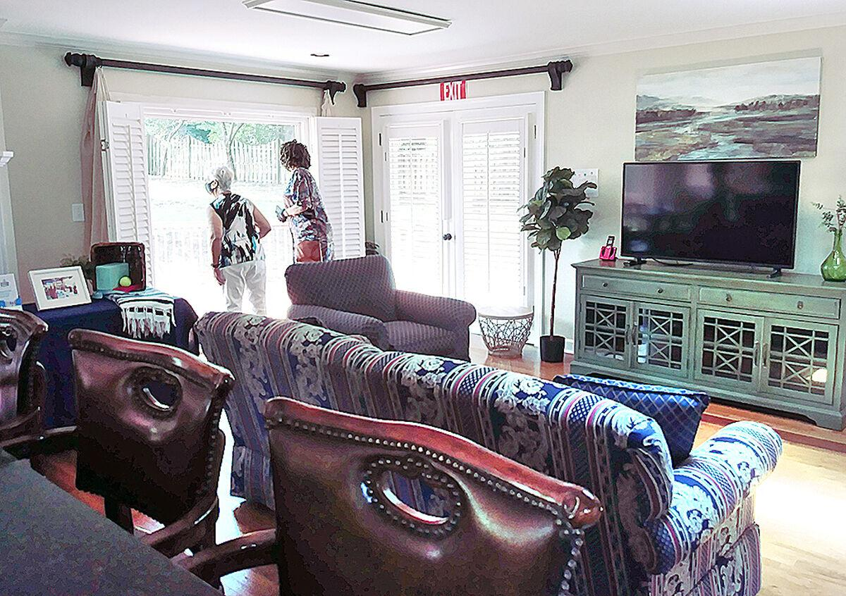 MAGNOLIA-guests look out of common area.jpg