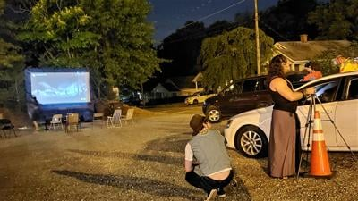 TUNES-employees work social distance at Monstercade_s third-base drive-in.jpg