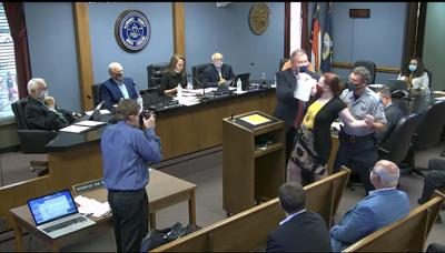Sheriff drags speaker at Alamance County public hearing from podium for asking question