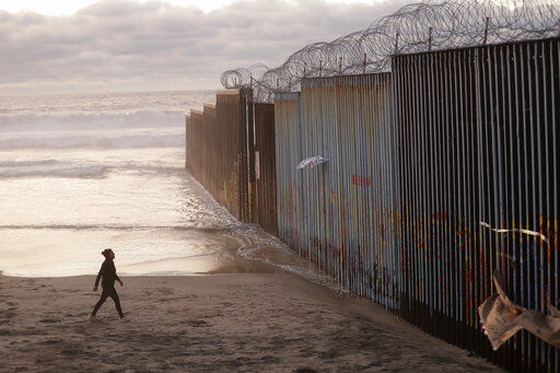 Border wall pic into water