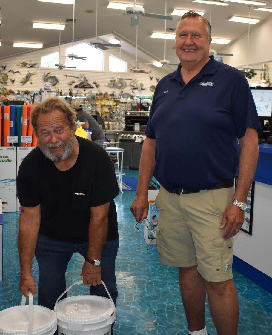 Customer Mike Potts and Pinch A Penny owner Ray Hoekstra