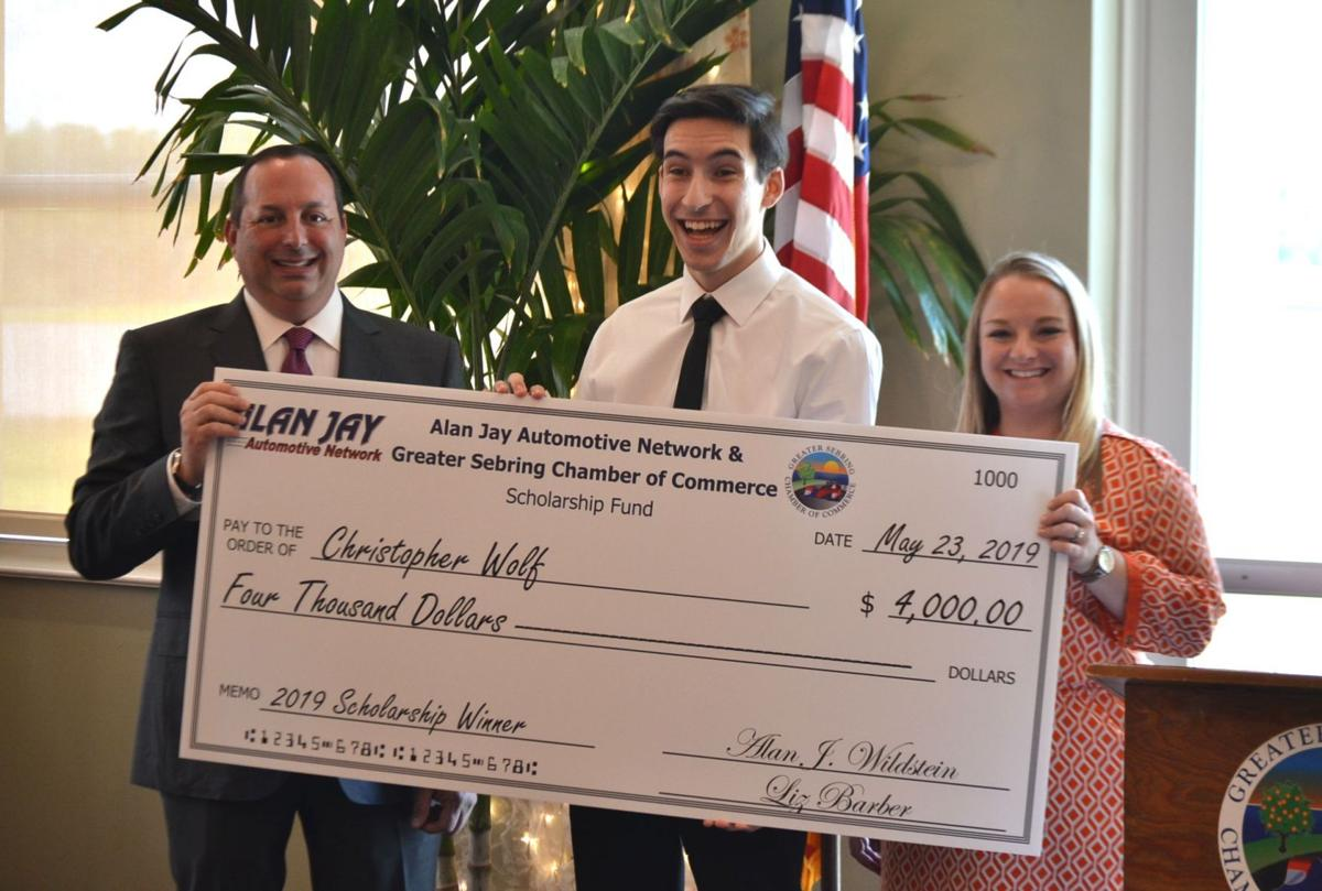 Christopher Wolf receives a $4,000 scholarship