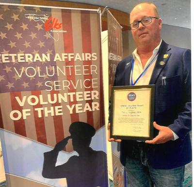 Hughes earns state veterans award