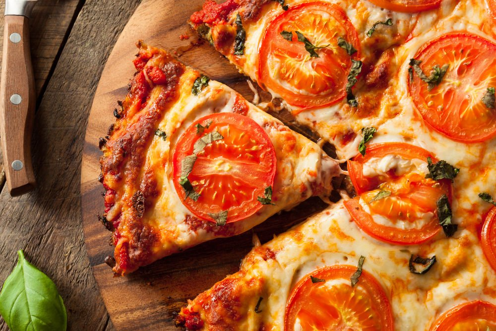 Cauliflower crust pizza with tomato and basil