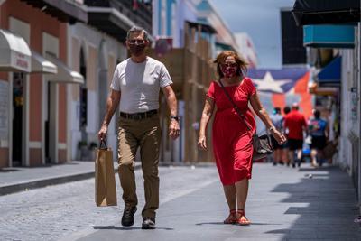 Puerto Rico abandons reopening plans after coronavirus spike