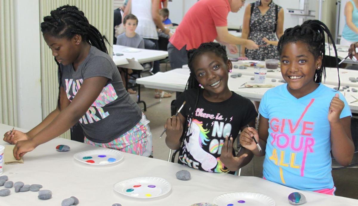 Kids enjoy painting rocks
