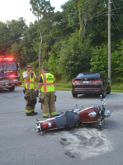 Motorcycle collides with car on Memorial Drive