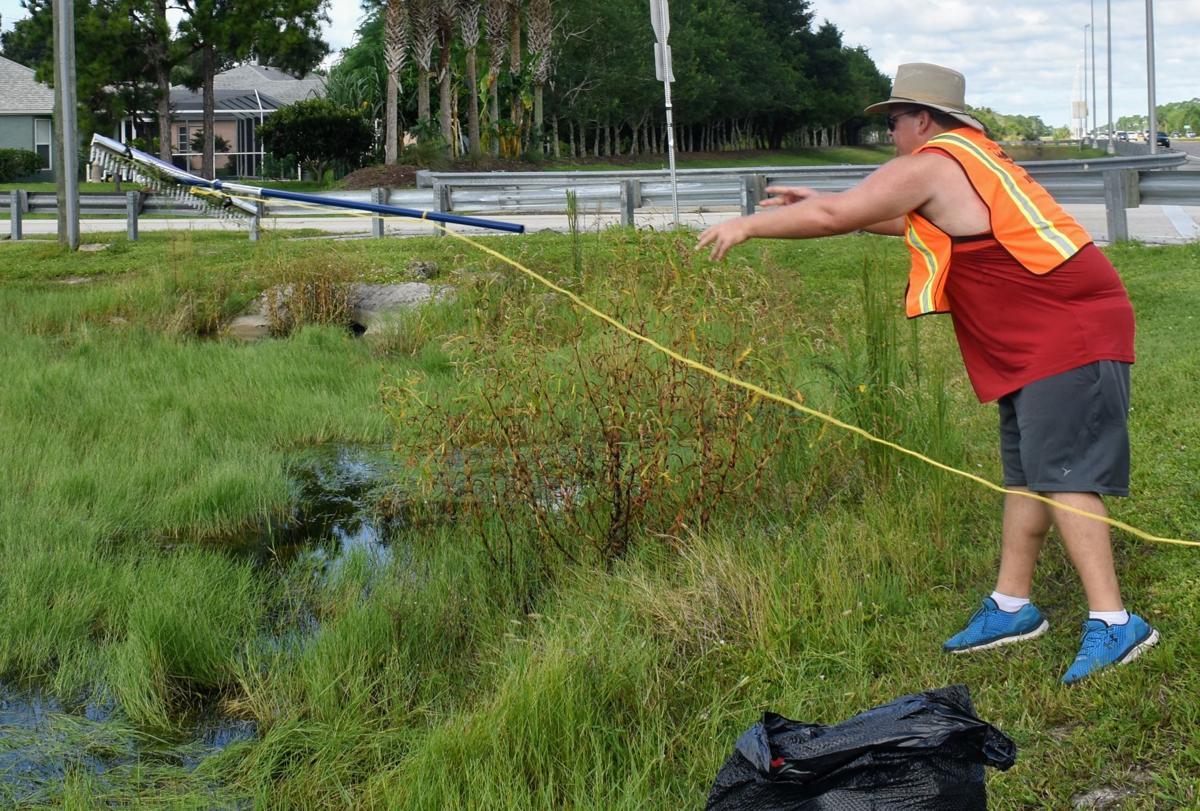Man throwing rake lake