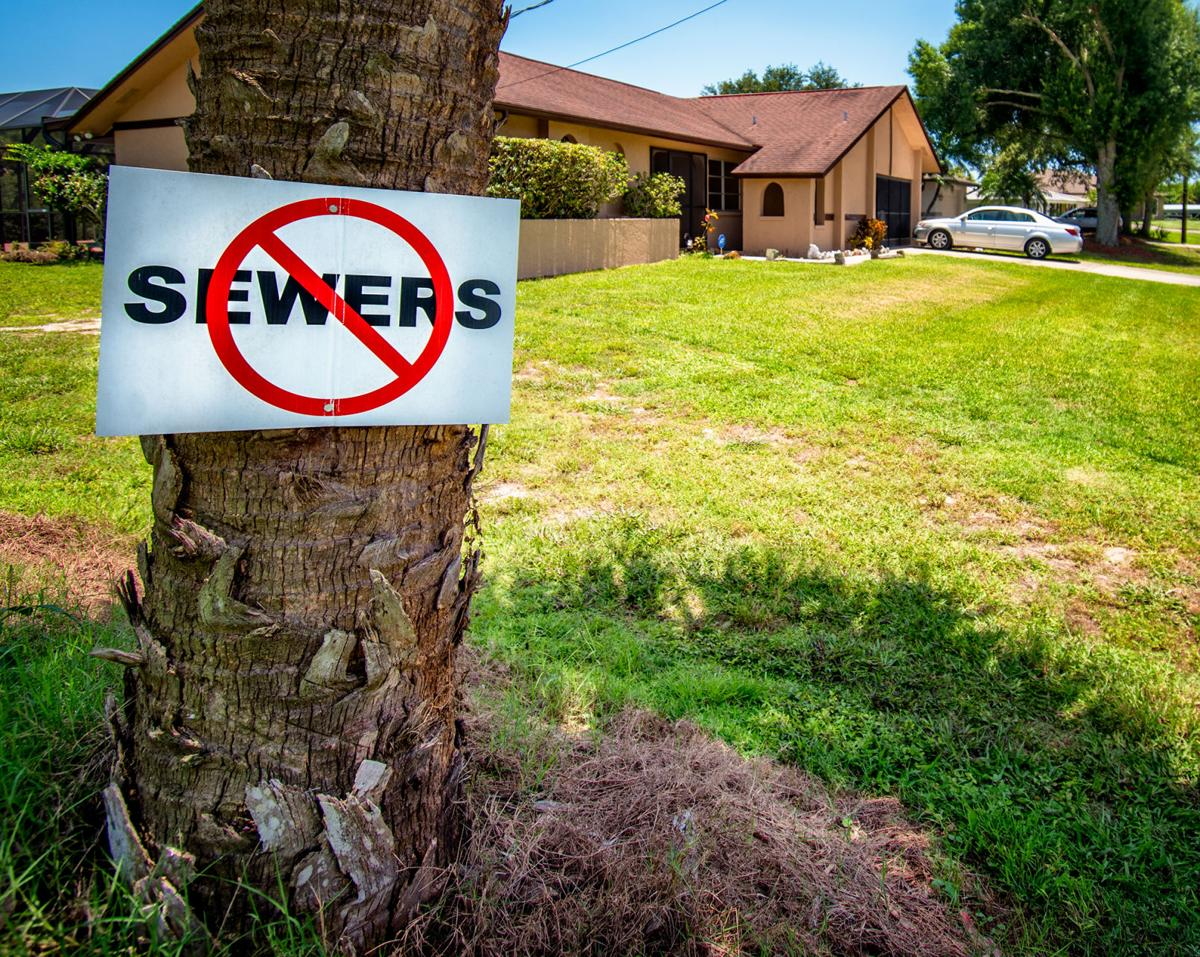 No Sewers Sign