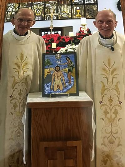 Twin paints icon of the Baptism for Epiphany cathedral