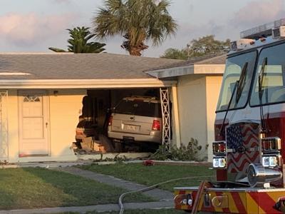 SUV slams into Port Charlotte house
