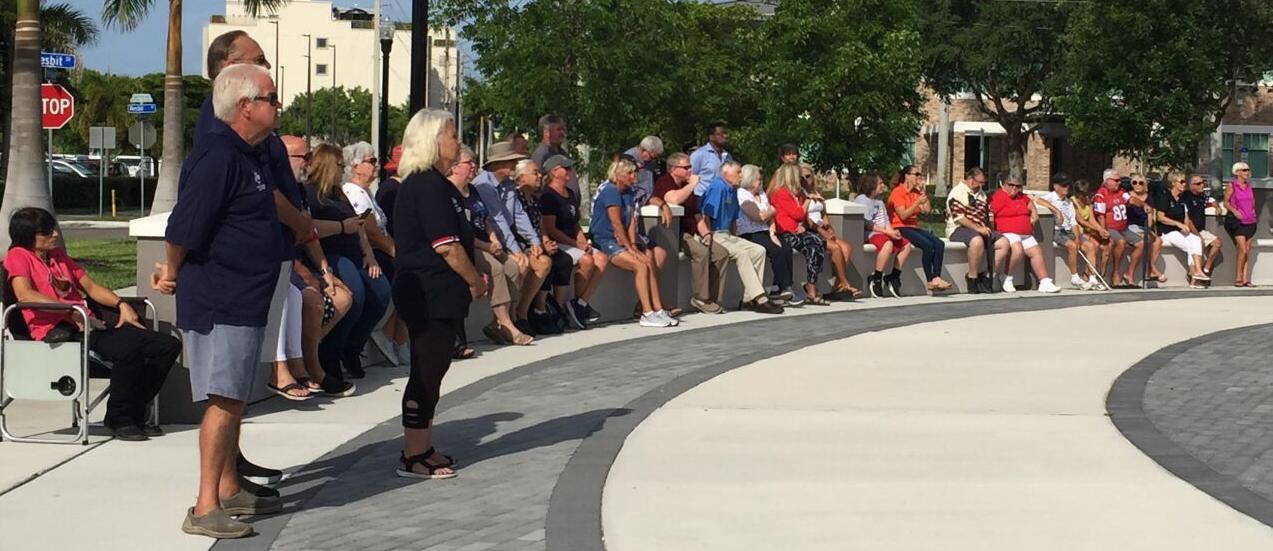 Onlookers observe Flag Day ceremony in Veterans Park, Punta Gorda