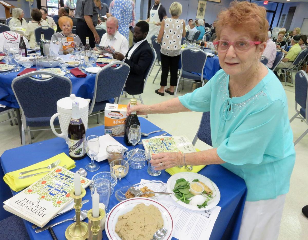 Leona Uchitelle sets up a Passover table