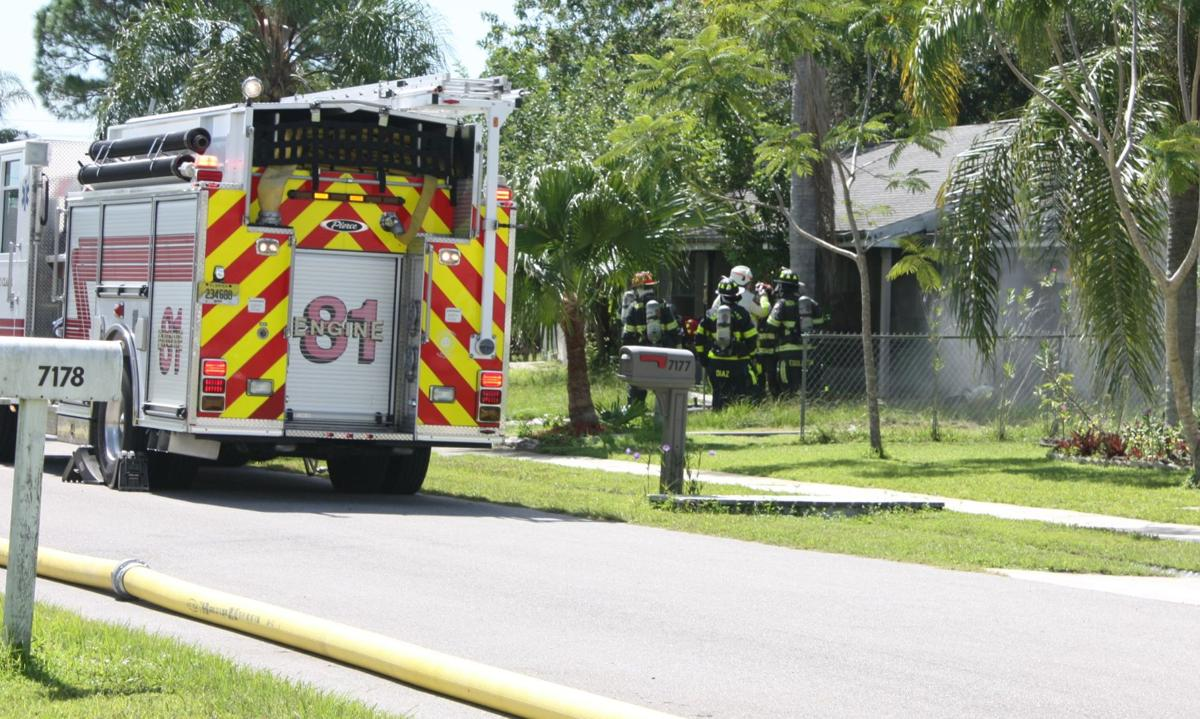 North Port Fire Department firefighters re-enter the home