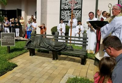 Bishop Dewane blesses Homeless Jesus statue