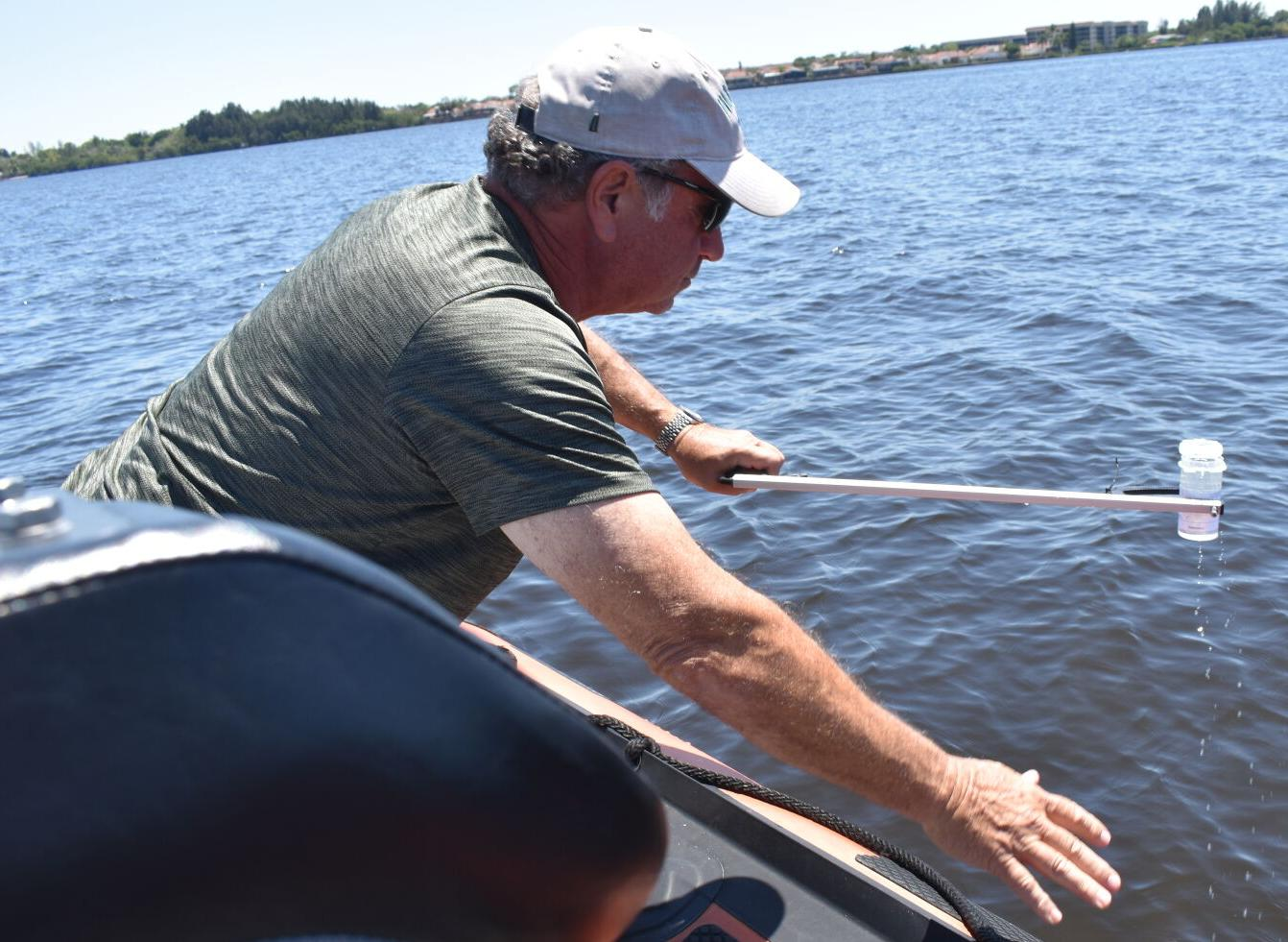 Waterkeeper Andy Mele taking samples in the Peace River off Punta Gorda