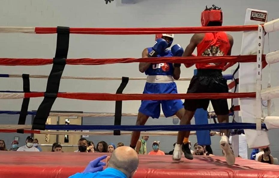 Boxing competitors in action