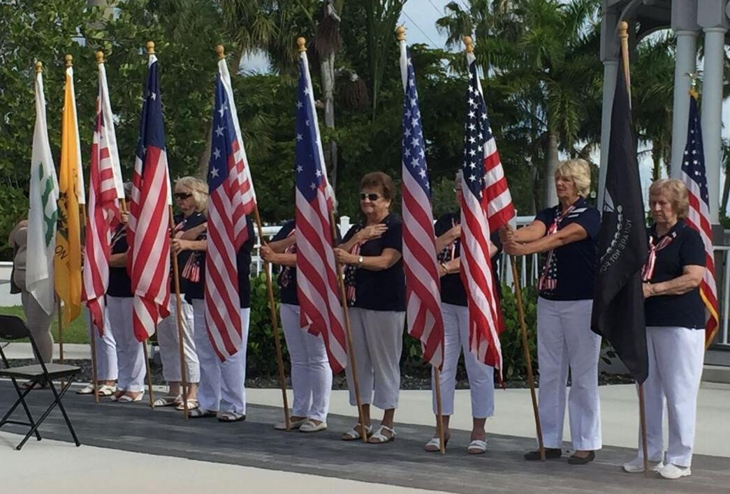 Elkettes from Punta Gorda Lodge 2060 display American flags on Flag Day