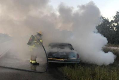 Car smoking from fire
