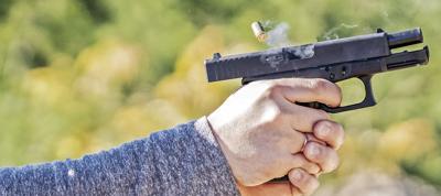 firing handgun