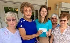 Pat Harris, E.J. Karpach, Reeves, Sue Gudenau, and Virginia (Ginny) Vernia give $500 to Tidewell p.c. coordinator Kaitlyn Reeves.jpg