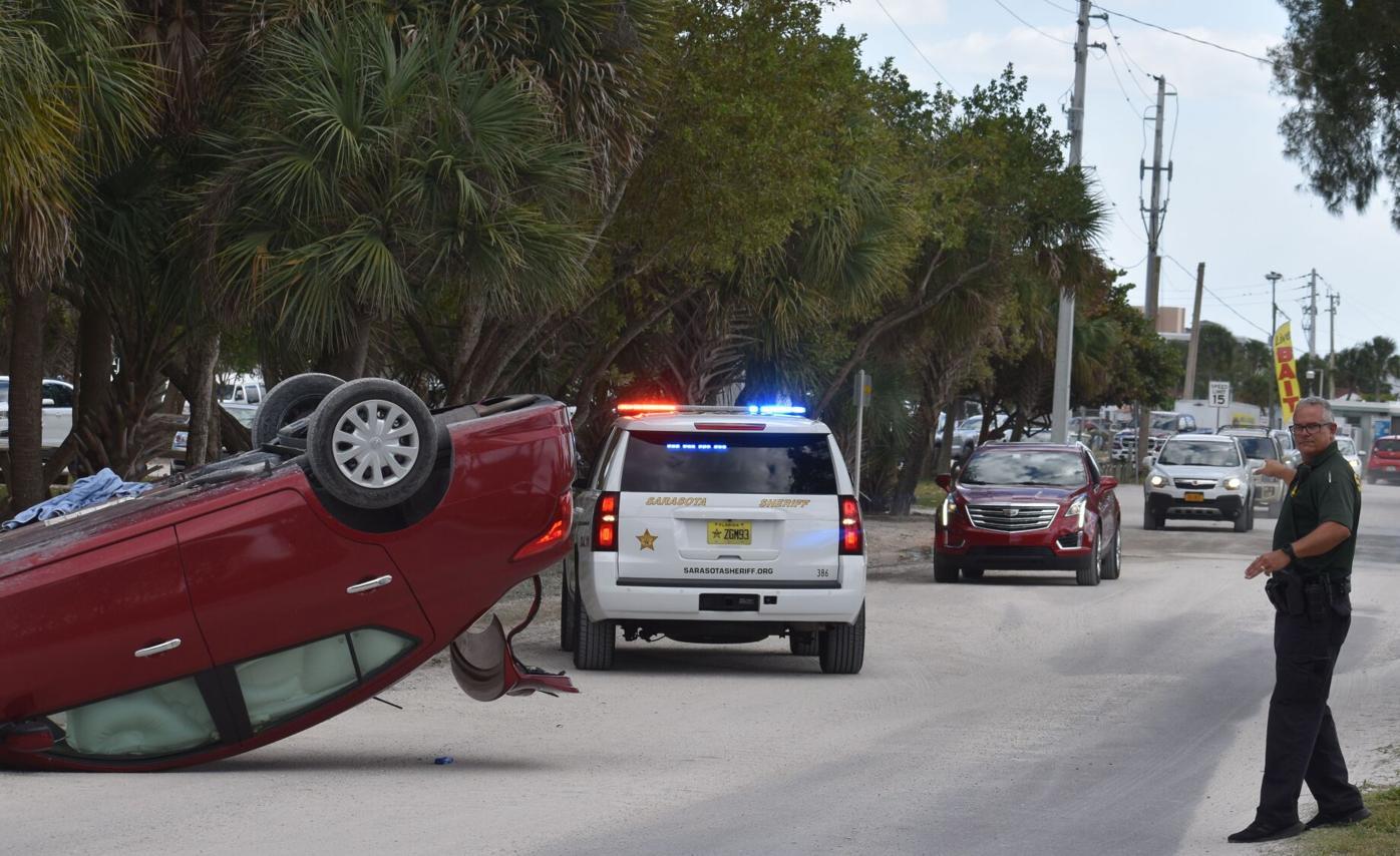 Car flips along Casey Key Road