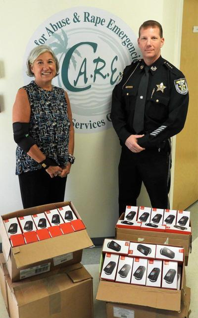 Sheriff Prummell Donates Phones to C.A.R.E. for Emergency Calls