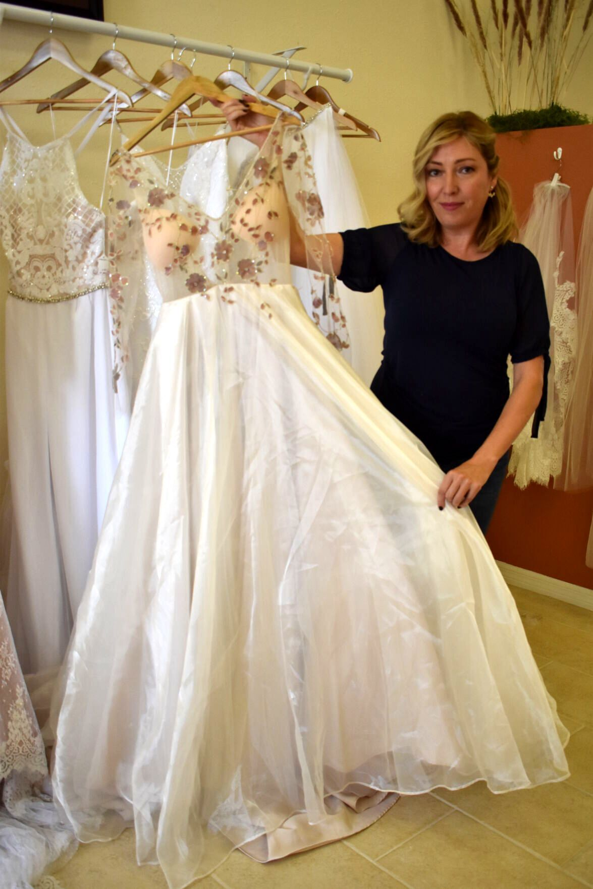 Designer Lily Rivera displays one of her popular bridal gowns