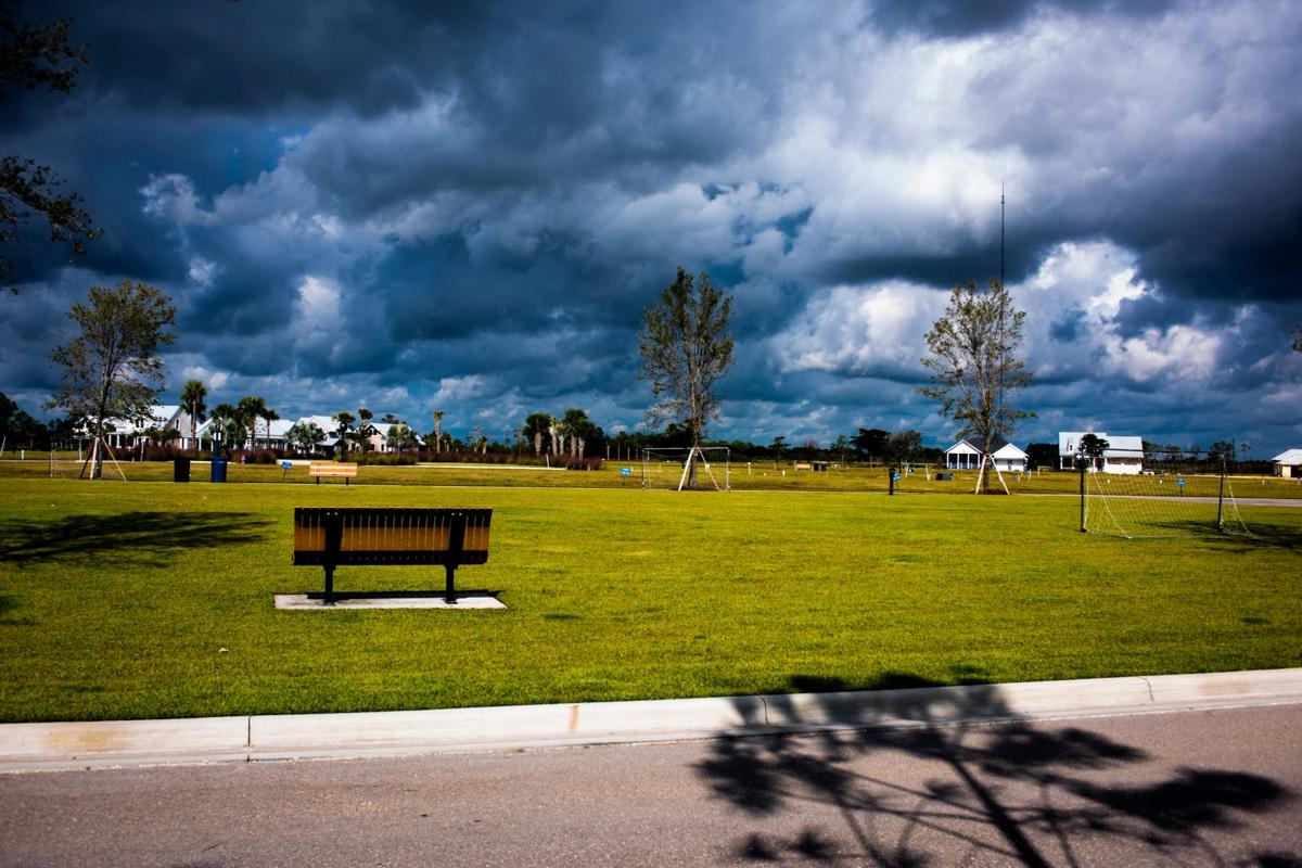 a stormy sky over the lawn at downtown babcock ranch