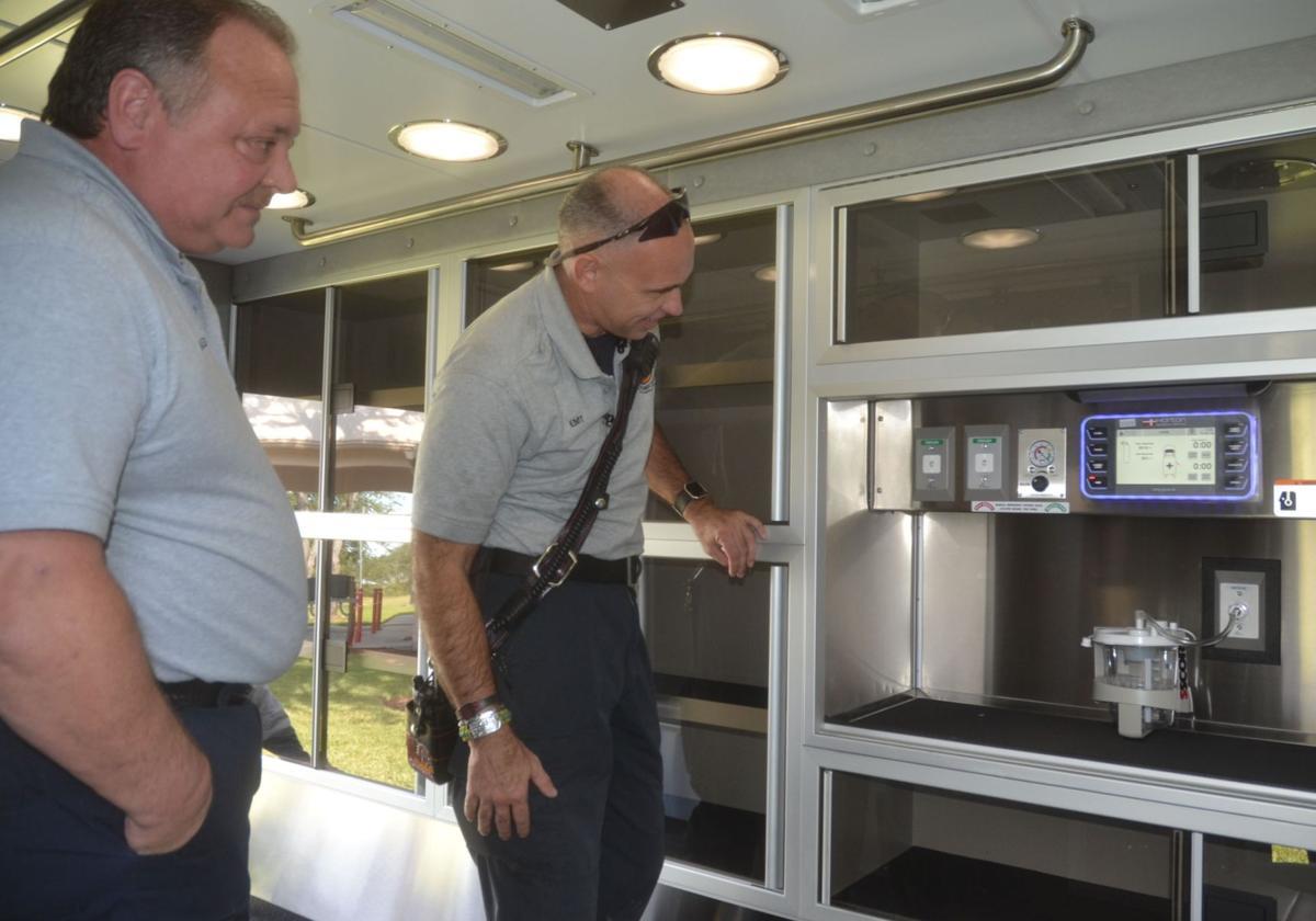 Brad Thompson and Sean Sweat check out vets ambulance
