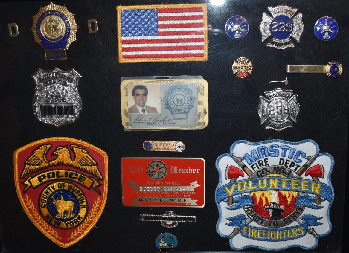 Robert Reichert's shields and badges from his days as a detective and volunteer firefighter