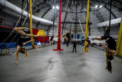 Students from the Sarasota High School circus magnet program train on the silks