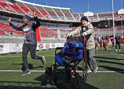 101-year-old crosses finish line at Ohio State 4 Miler
